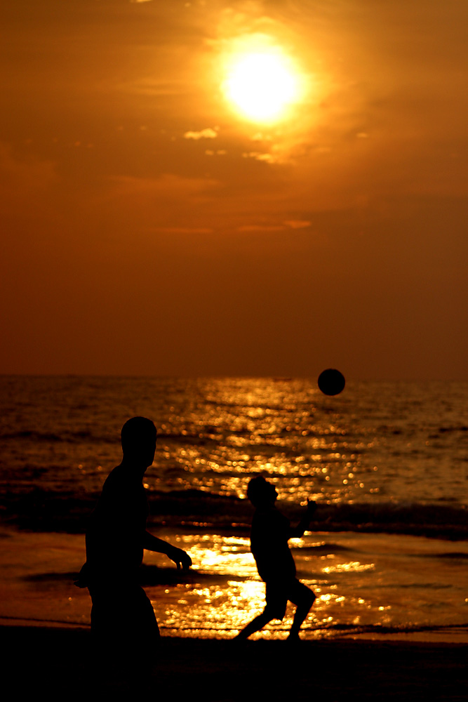 Boys play soccer on Lighthouse Beach, Kovalam